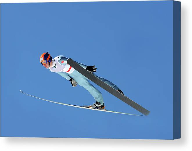Helmet Canvas Print featuring the photograph Ski Jumper Flying by Technotr