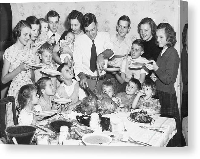 Mid Adult Women Canvas Print featuring the photograph Thanksgiving With Large Family by Bettmann