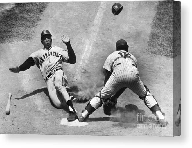 Headwear Canvas Print featuring the photograph Willie Mays Sliding Into Home Plate by Bettmann