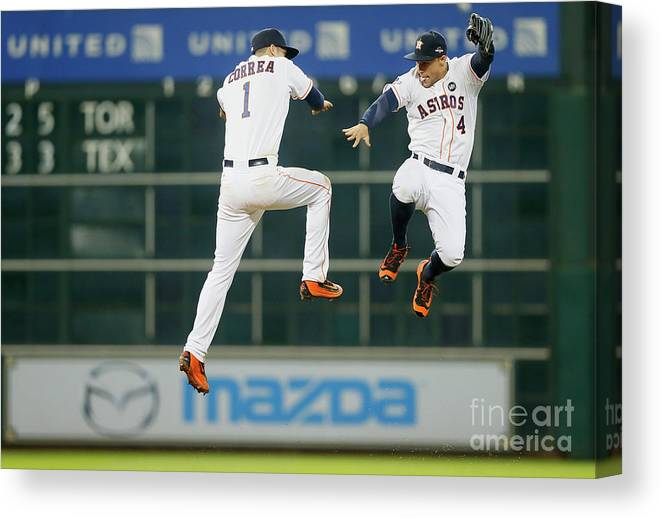 American League Baseball Canvas Print featuring the photograph George Springer and Carlos Correa by Bob Levey