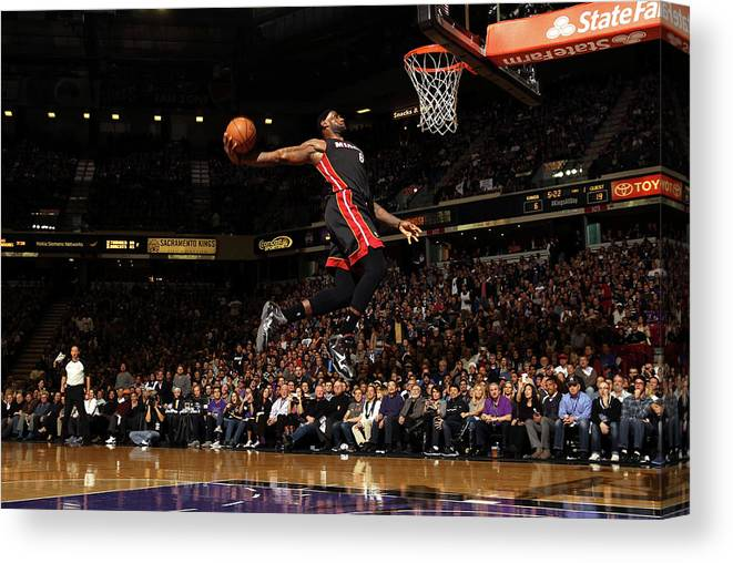 Nba Pro Basketball Canvas Print featuring the photograph Lebron James by Ezra Shaw