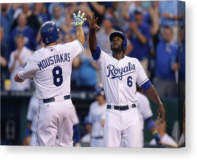 American League Baseball Canvas Print featuring the photograph Mike Moustakas and Lorenzo Cain by Ed Zurga