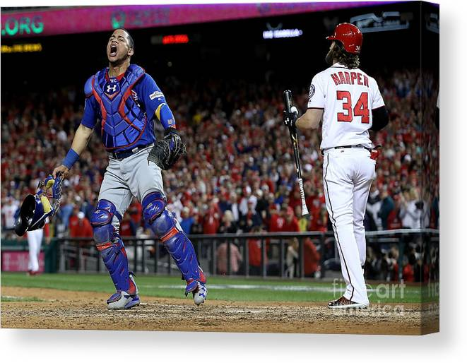 People Canvas Print featuring the photograph Willson Contreras and Bryce Harper by Win Mcnamee