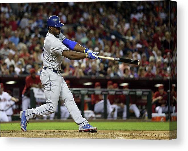 Los Angeles Dodgers Canvas Print featuring the photograph Yasiel Puig by Christian Petersen