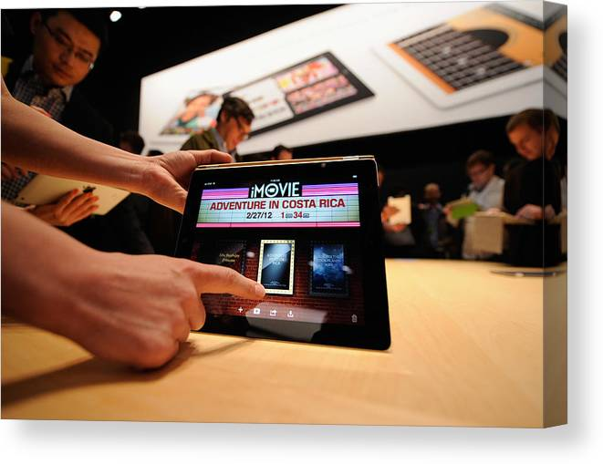 Event Canvas Print featuring the photograph Apple Unveils Updated iPad In San Francisco by Kevork Djansezian
