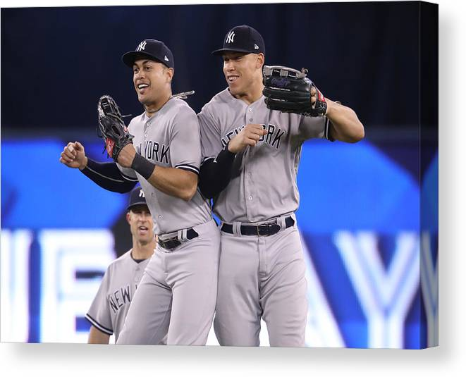 People Canvas Print featuring the photograph Aaron Judge and Giancarlo Stanton by Tom Szczerbowski