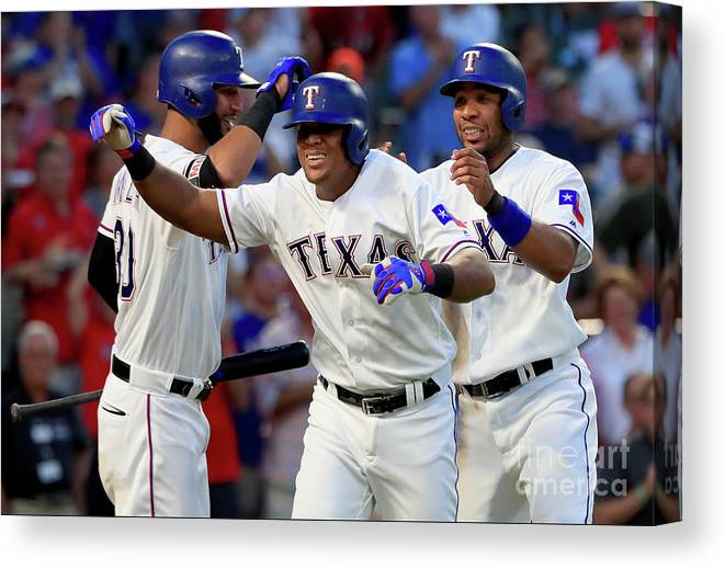 Adrian Beltre Canvas Print featuring the photograph Adrian Beltre, Elvis Andrus, and Nomar Mazara by Tom Pennington