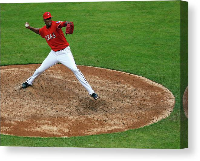 American League Baseball Canvas Print featuring the photograph Alexi Ogando by Tom Pennington