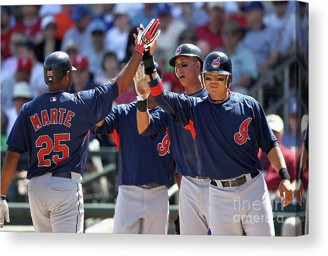 Anderson Hernández Canvas Print featuring the photograph Andy Marte, Michael Brantley, and Shin-soo Choo by Christian Petersen