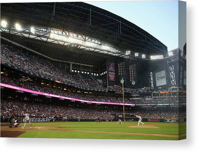 Baseball Pitcher Canvas Print featuring the photograph Angel Pagan and Brandon Mccarthy by Christian Petersen
