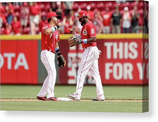 Great American Ball Park Canvas Print featuring the photograph Brandon Phillips and Eugenio Suarez by Andy Lyons