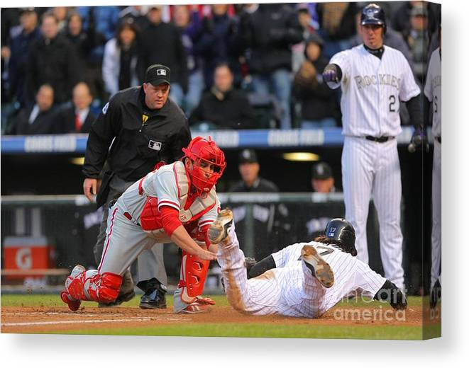 Playoffs Canvas Print featuring the photograph Carlos Ruiz and Todd Helton by Doug Pensinger