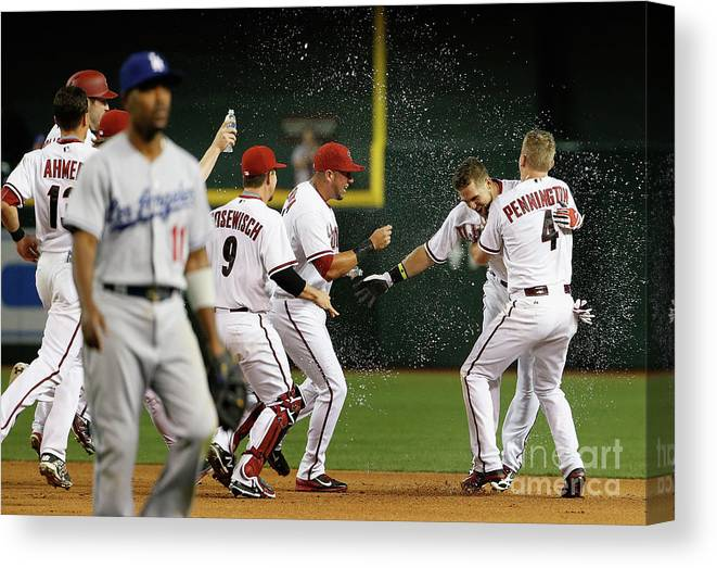 American League Baseball Canvas Print featuring the photograph Cliff Pennington, Ender Inciarte, and David Peralta by Christian Petersen