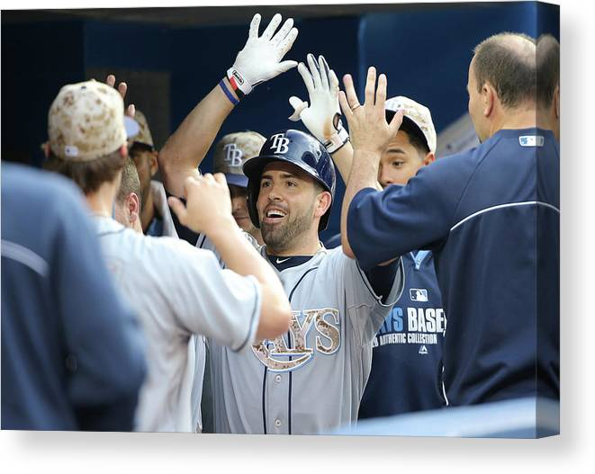 American League Baseball Canvas Print featuring the photograph David Dejesus by Tom Szczerbowski