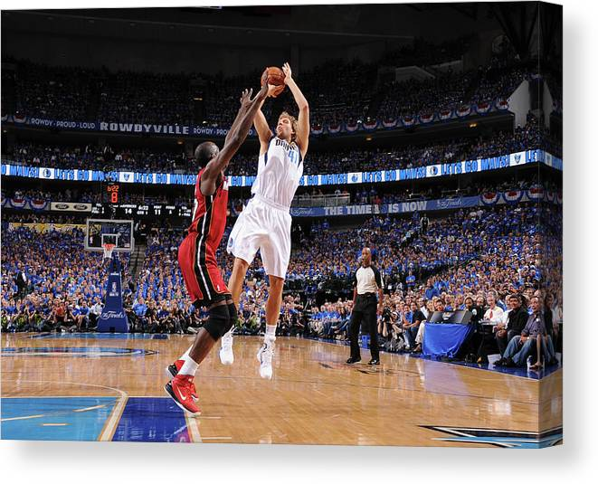 Playoffs Canvas Print featuring the photograph Dirk Nowitzki and Joel Anthony by Andrew D. Bernstein