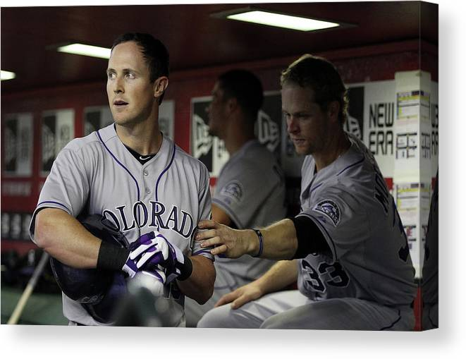 Ninth Inning Canvas Print featuring the photograph Drew Stubbs and Justin Morneau by Christian Petersen
