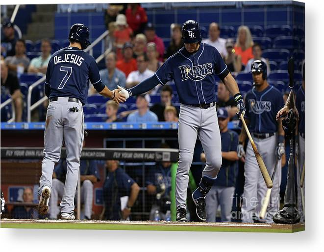 American League Baseball Canvas Print featuring the photograph Evan Longoria and David Dejesus by Mike Ehrmann