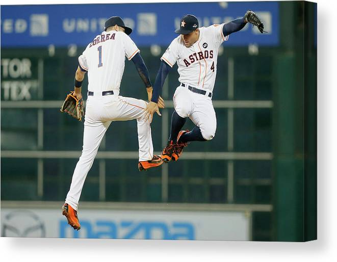 People Canvas Print featuring the photograph George Springer and Carlos Correa by Bob Levey