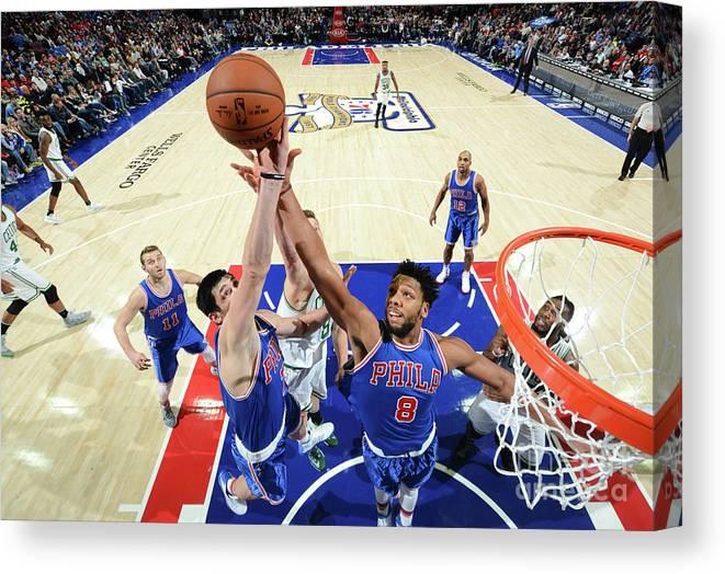 Nba Pro Basketball Canvas Print featuring the photograph Jahlil Okafor and Ersan Ilyasova by Jesse D. Garrabrant