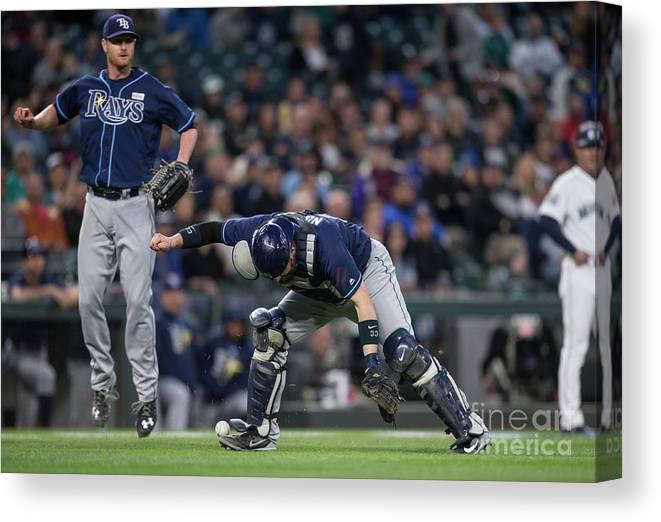 Baseball Catcher Canvas Print featuring the photograph Jarrod Dyson, Derek Norris, and Alex Cobb by Stephen Brashear