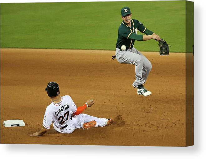 Double Play Canvas Print featuring the photograph Jed Lowrie and Giancarlo Stanton by Mike Ehrmann