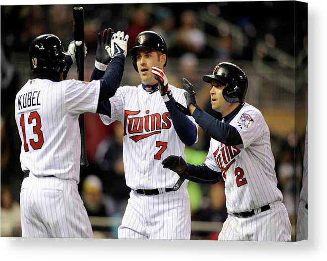 Game Two Canvas Print featuring the photograph Joe Mauer, Jason Kubel, and Brian Dozier by Hannah Foslien
