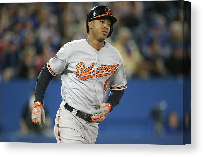 American League Baseball Canvas Print featuring the photograph Jonathan Schoop by Tom Szczerbowski