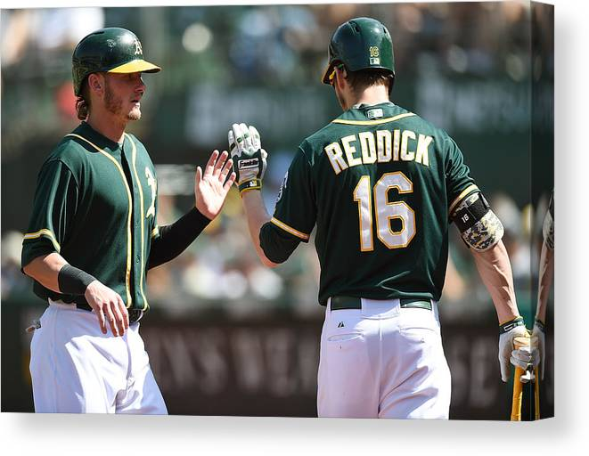 Ninth Inning Canvas Print featuring the photograph Josh Reddick and Josh Donaldson by Thearon W. Henderson