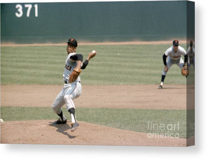 Baseball Pitcher Canvas Print featuring the photograph Juan Marichal by Louis Requena