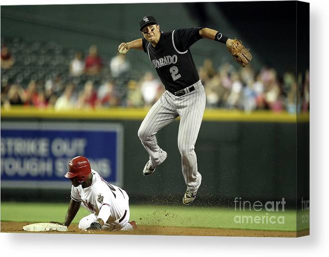 Double Play Canvas Print featuring the photograph Justin Upton and Troy Tulowitzki by Christian Petersen