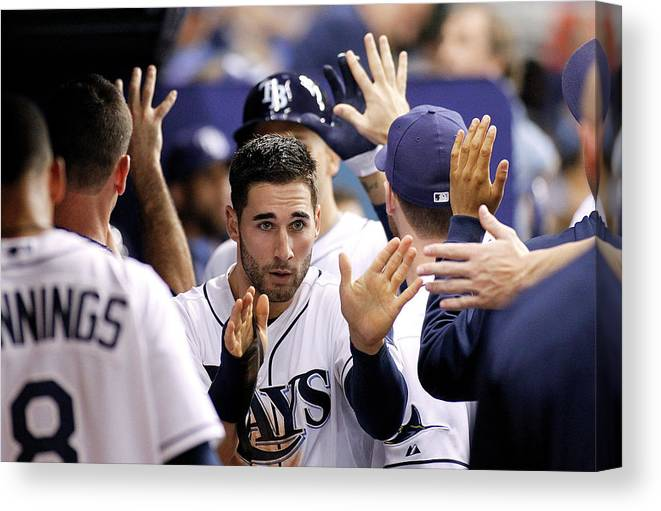 American League Baseball Canvas Print featuring the photograph Kevin Kiermaier and James Loney by Brian Blanco