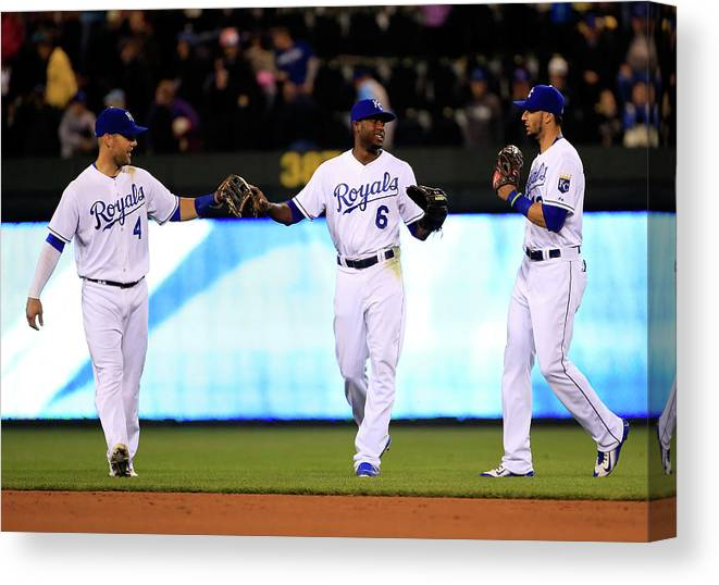 People Canvas Print featuring the photograph Lorenzo Cain, Alex Gordon, and Paulo Orlando by Jamie Squire