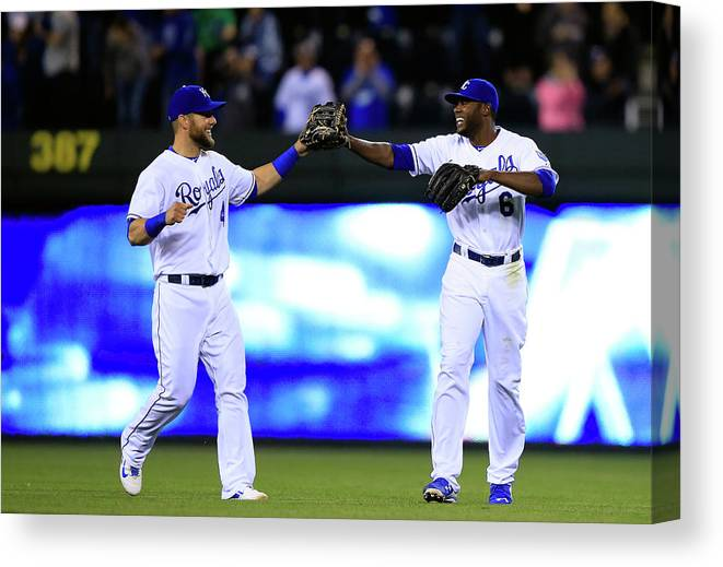 American League Baseball Canvas Print featuring the photograph Lorenzo Cain and Alex Gordon by Jamie Squire