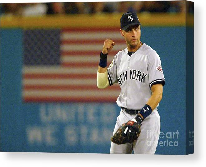 Fist Canvas Print featuring the photograph Luis Castillo and Derek Jeter by Jed Jacobsohn