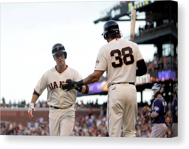 San Francisco Canvas Print featuring the photograph Mike Morse and Buster Posey by Ezra Shaw