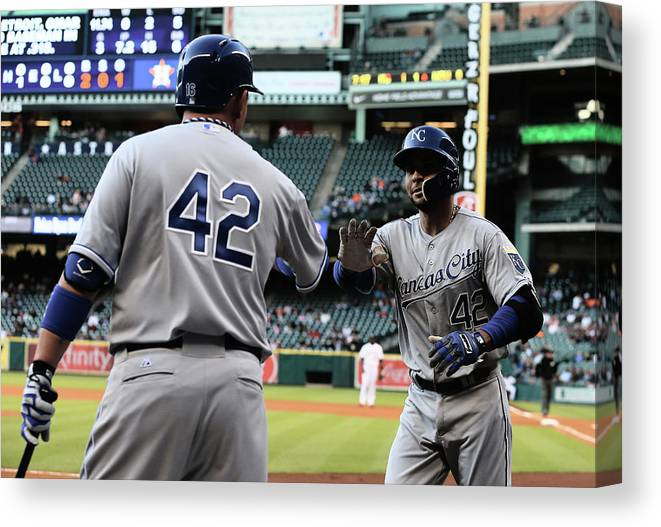 American League Baseball Canvas Print featuring the photograph Omar Infante and Billy Butler by Scott Halleran