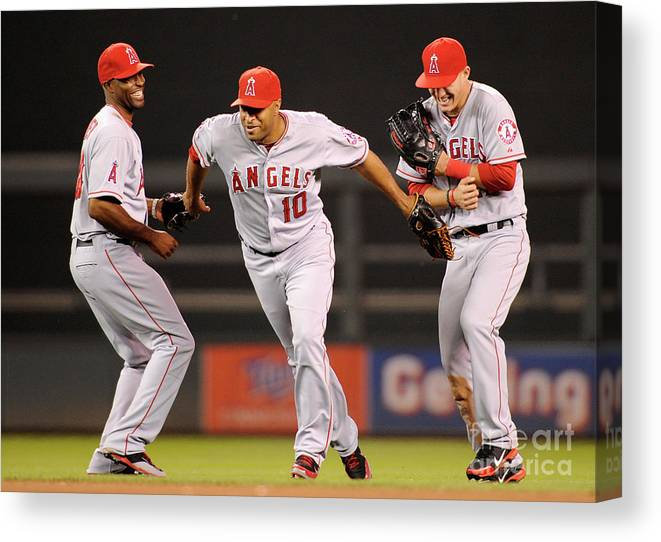 American League Baseball Canvas Print featuring the photograph Torii Hunter, Vernon Wells, and Mike Trout by Hannah Foslien