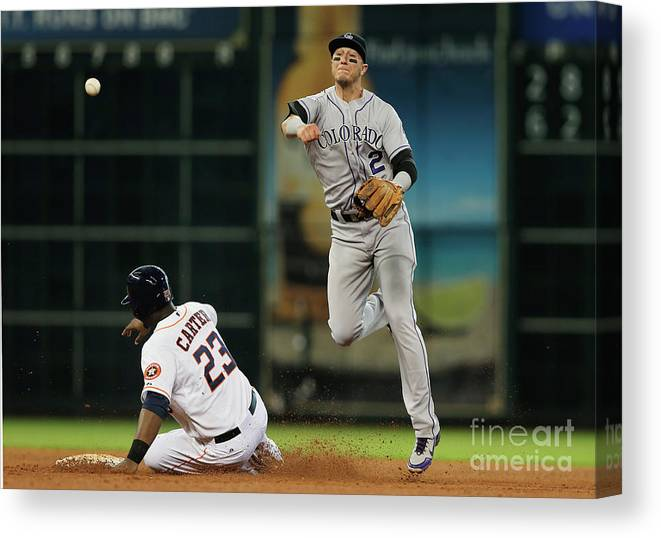 American League Baseball Canvas Print featuring the photograph Troy Tulowitzki and Chris Carter by Scott Halleran