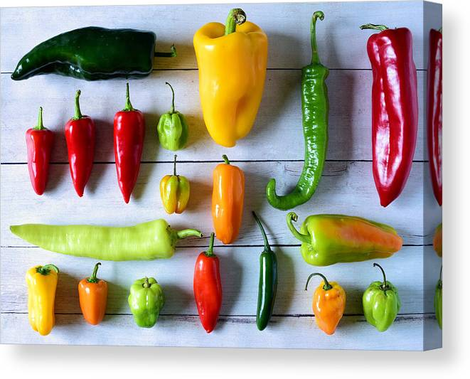 Orange Color Canvas Print featuring the photograph Variety of fresh peppers by Photo by Cathy Scola