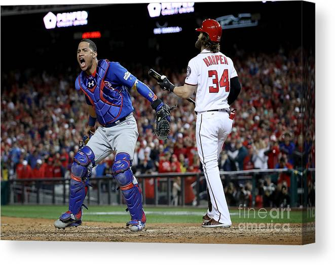 American League Baseball Canvas Print featuring the photograph Willson Contreras and Bryce Harper by Win Mcnamee