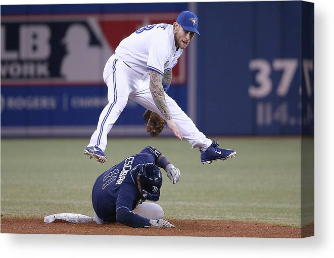 Double Play Canvas Print featuring the photograph Yunel Escobar and Brett Lawrie by Tom Szczerbowski