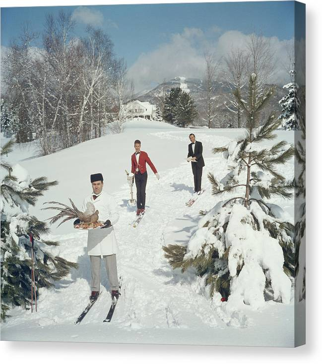 Skiing Canvas Print featuring the photograph Skiing Waiters by Slim Aarons