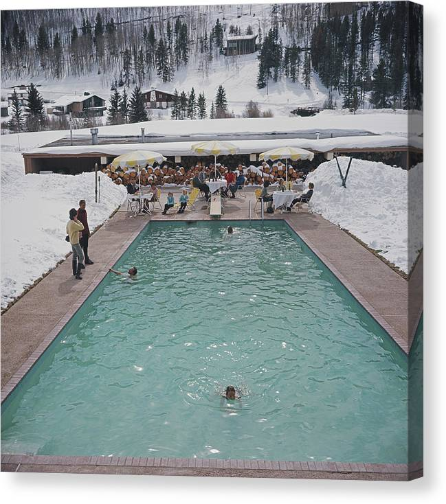 Child Canvas Print featuring the photograph Snow Round The Pool by Slim Aarons