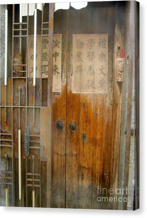 Door Canvas Print featuring the photograph Abandoned Wooden Door With Gate by Kathy Daxon