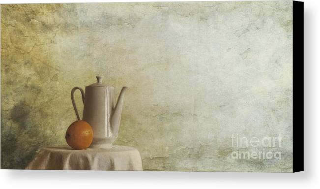 Table Canvas Print featuring the photograph A Jugful Tea And A Orange by Priska Wettstein