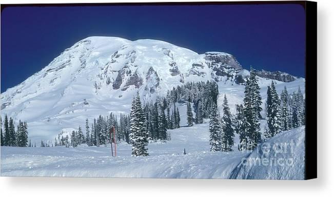 Mt. Rainier Canvas Print featuring the photograph Mt. Rainier by Larry Keahey