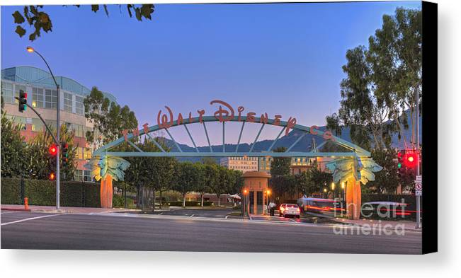 The Walt Disney Company In Burbank; Ca.; Sunset; Blue Sky; Magic Hour; Twilight; Car Lights Streaking; Beautiful Canvas Print featuring the photograph The Walt Disney Company In Burbank Ca. Sunset by David Zanzinger