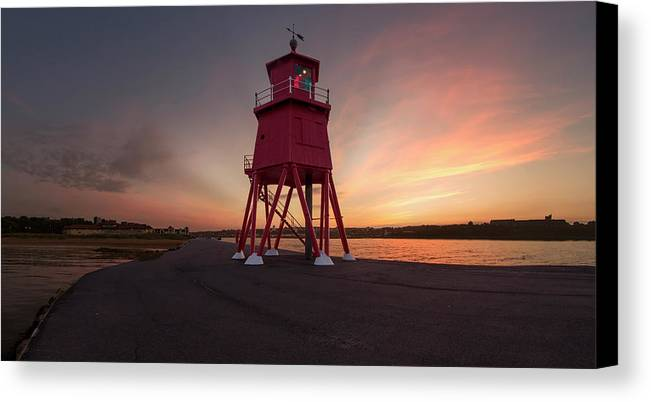 Dawn Canvas Print featuring the photograph Herd Groyne Lighthouse On The Water S by John Short