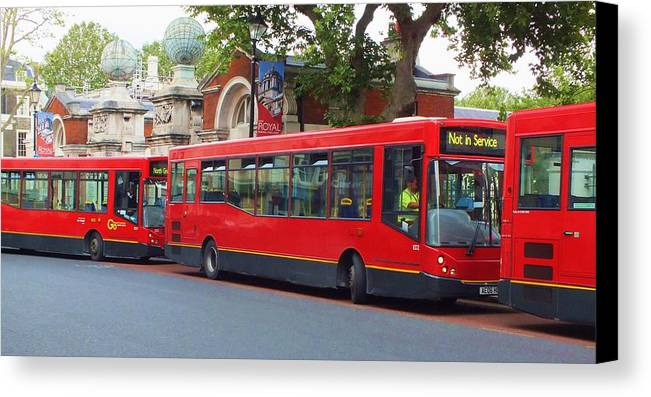 Buses Canvas Print featuring the photograph A Bevy Of Buses by Anna Villarreal Garbis