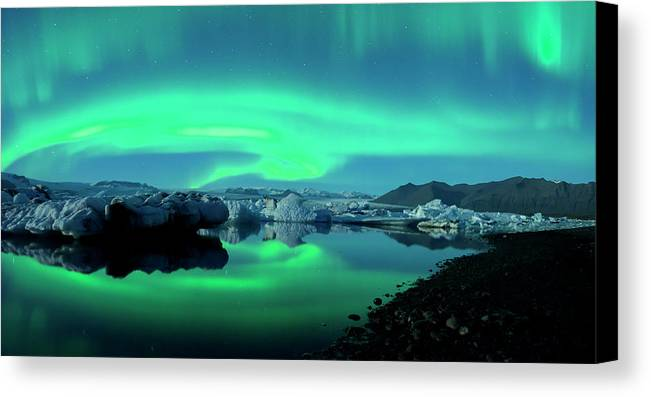 Auroras Canvas Print featuring the photograph Dancing Auroras Jokulsarlon Iceland by Brad Scott